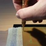 Punzonatura con PCB bloccato dal nastro